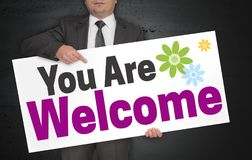 You are Welcome poster is held by businessman.  Royalty Free Stock Images