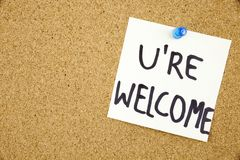 You Are wellcome sign written on sticky note pinned on pinboard Royalty Free Stock Image