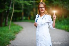 You will need to know this. a young girl who is a doctor stands stock images