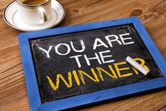 You are the winner. Handwritten on blackboard Stock Photos