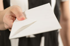 This is for you!. Woman hand holding a white envelope give it away as bribe Stock Photography