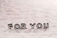 For you word on white sand Royalty Free Stock Photography