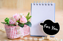 For you wording in black tag and open blank diary with flowers. Stock Images