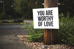 You Are Worthy of Love Signage on Brown Wooden Post Taken Royalty Free Stock Photo