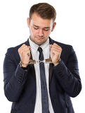 Youbg bussinessman with handcuffs over hands Royalty Free Stock Photo