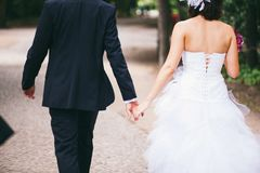 A youg couple holding their hands stock photo