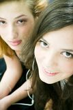 Youg Girls. Two young girls sharing a pair of headphones Stock Photo