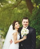 Youg Happy wedding couple. Caucasian bride and groom embracing Royalty Free Stock Images