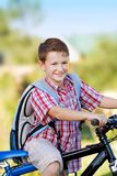 Youg school boy. Young school boy on a bicycle Royalty Free Stock Photography