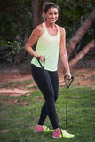 Youg woman using resistance bands Royalty Free Stock Photography