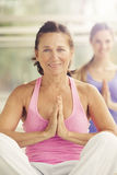 Youga class. Mature women smiling in yoga class Royalty Free Stock Photography