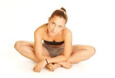 Youga do treinamento da mulher nova Fotografia de Stock Royalty Free