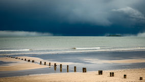 Youghal beach Ireland seascape. Seascape at Youghal strand Ireland showing dramatic clouds in the background Stock Photo