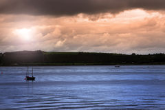 Youghal boats at dusk. Boats on the river edge in youghal a beautiful irish town on the coast Royalty Free Stock Image