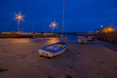 Youghal Hardbour at night. The harbour at Youghal Co. Cork at night.  A harbour which was once a busy fishing port, is not a home to a few crabing boats and Stock Photo