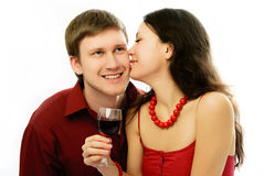 Yougn couple drink vine and kiss Royalty Free Stock Images