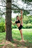 Yougn woman stretching   outdoor in the city park Stock Photography