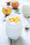 Yougurt with peaches slice. Selective focus Stock Image