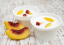 Yougurt with peaches Stock Photos