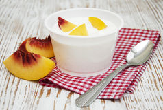 Yougurt with peaches Stock Image