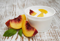 Yougurt with peaches Stock Photography