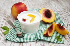 Yougurt With Peaches Stock Photo