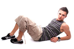 Youn casual man posing. Isolated in white background stock photography