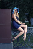 Youn fashionable women sit on metal fence unusual Royalty Free Stock Images
