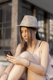 Youn girl with smart phone Stock Image