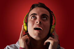 Youn man listening to music. With headphones Stock Photo