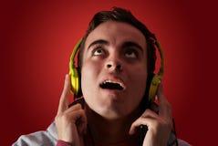 Youn man listening to music Stock Photo