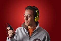 Youn man listening to music. With headphones Stock Photos
