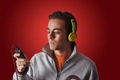 Youn man listening to music Stock Photos