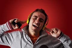 Youn man listening to music Stock Photography
