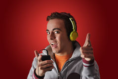 Youn man listening to music Stock Images