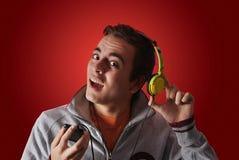 Youn man listening to music Royalty Free Stock Photo