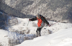 Youn man skiing. Young man skiing with backpack on a free ride Stock Photos