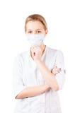 Youn nurse woman in mask isolated Stock Photos