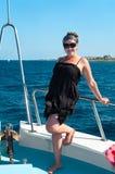 Youn woman on yacht board Stock Photo