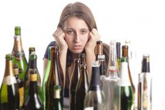 Yound beautiful woman in depression, drinking alcohol Stock Photos