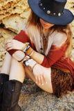 Yound beautiful woman fashion portrait, indie hippie style, stones backdrop stock photos