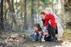 Yound beautiful woman and two little girls stock photos