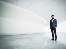 Yound bussines man in the modern white interior Royalty Free Stock Image