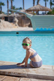 Yound child sit on swimming pool Royalty Free Stock Photo