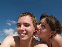 Yound Couple on beach. Lovely couple lying on Beach smiling sunny day Royalty Free Stock Photos