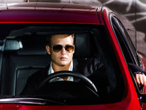 Yound elegant guy driving modern car Royalty Free Stock Photo