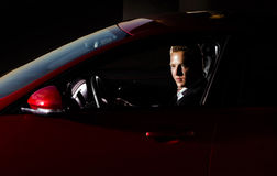 Yound elegant guy driving modern car Royalty Free Stock Image