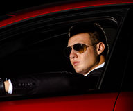 Yound elegant guy driving modern car Stock Images
