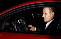 Yound elegant guy driving modern car Stock Photo
