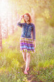 Yound ginger-haired woman Stock Photo